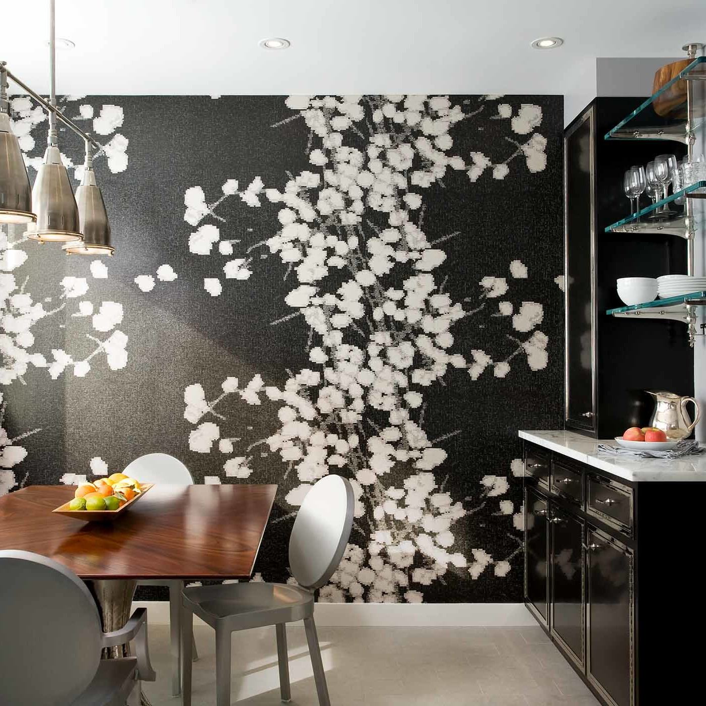 Graphic, bold wallpaper adding drama and impact to the eat-in dining nook in a NYC penthouse apartment