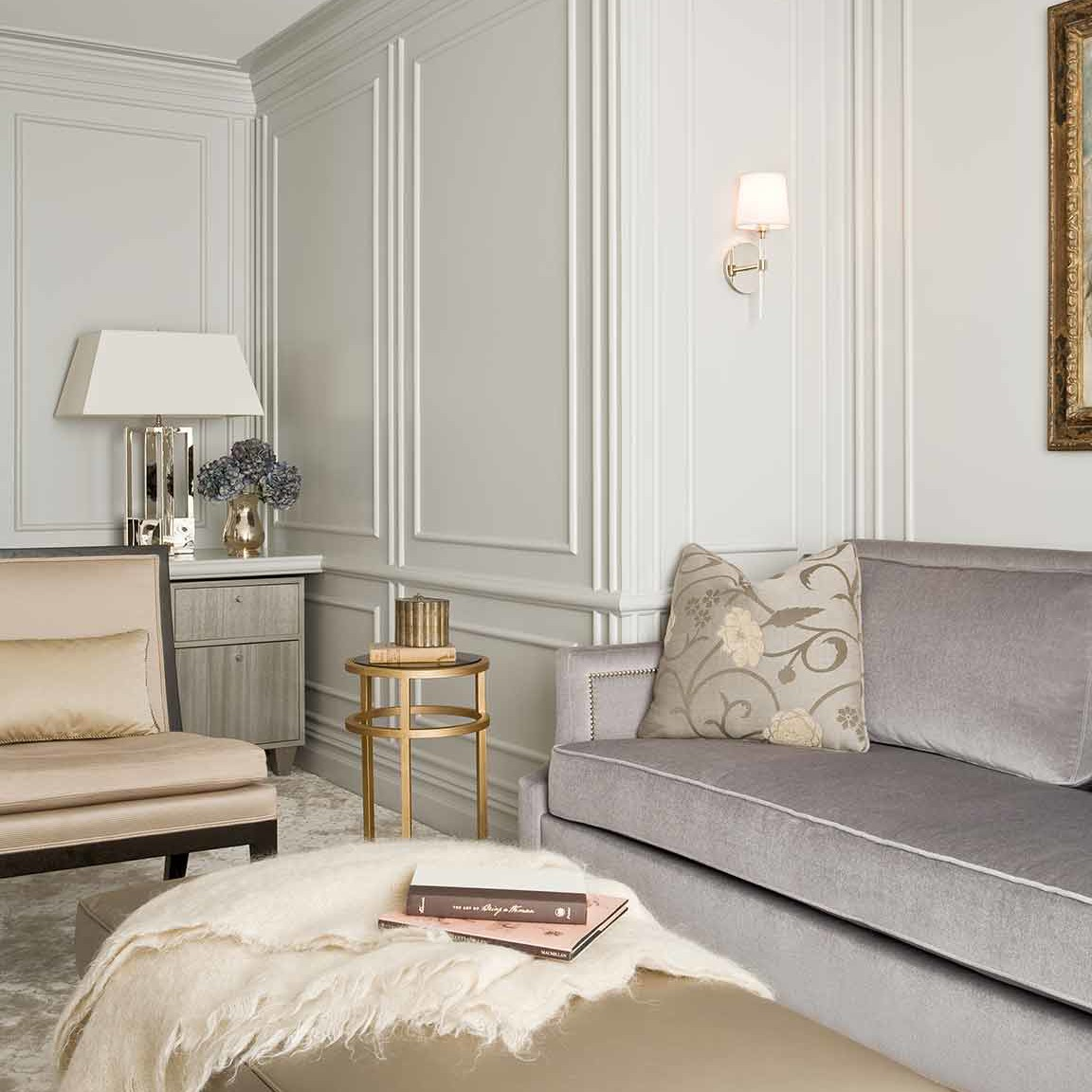 NYC home office library interior design with magnificent silk wall-to-wall carpet and a muted gray mohair sofa