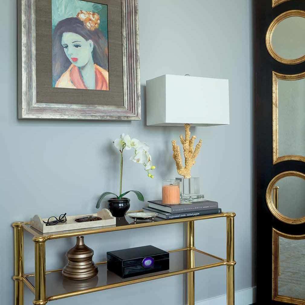 An antique console from lee calicchio, ltd in a Designer showhouse bedroom designed by Darci Hether New York