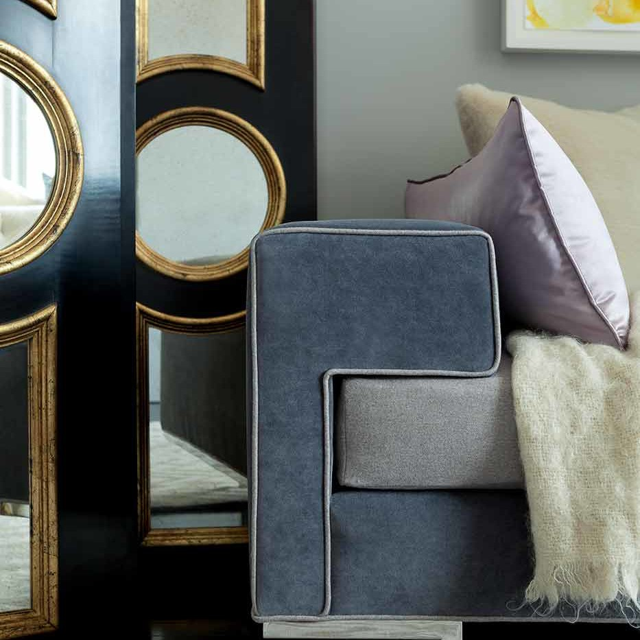 Transitional curved-back chair made cozy by a richly textured cream fabric in NYC Designer Showhouse