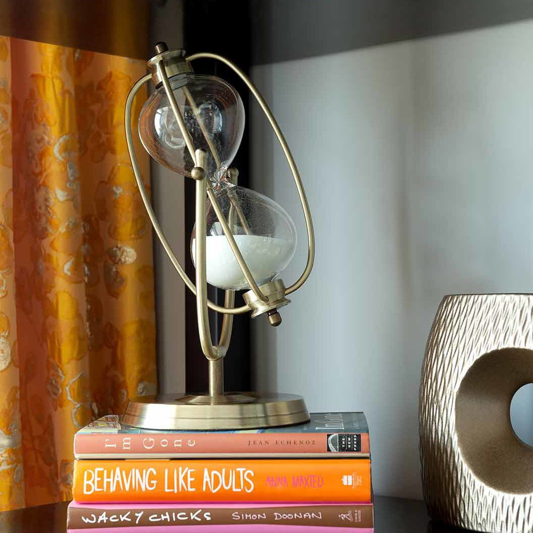 Whimsically oversized hourglass in a Designer showhouse bedroom designed by Darci Hether New York