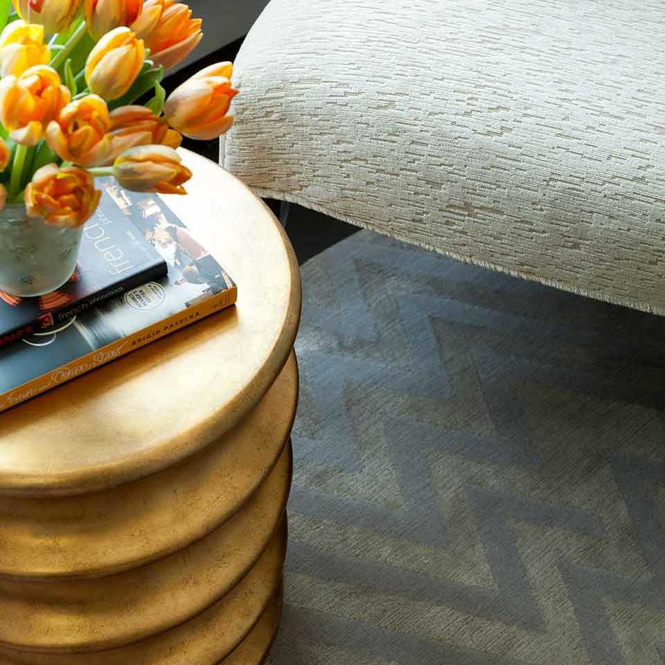 A modern gold accent stool in NYC Designer Showhouse