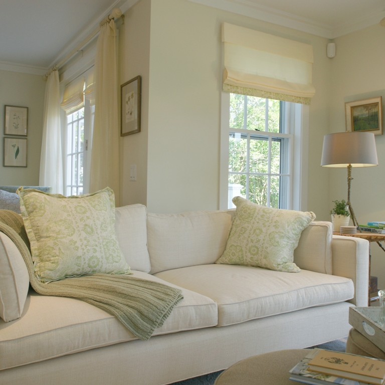 Living room interior design with light wood floor with white and beige walls in a Nantucket residence