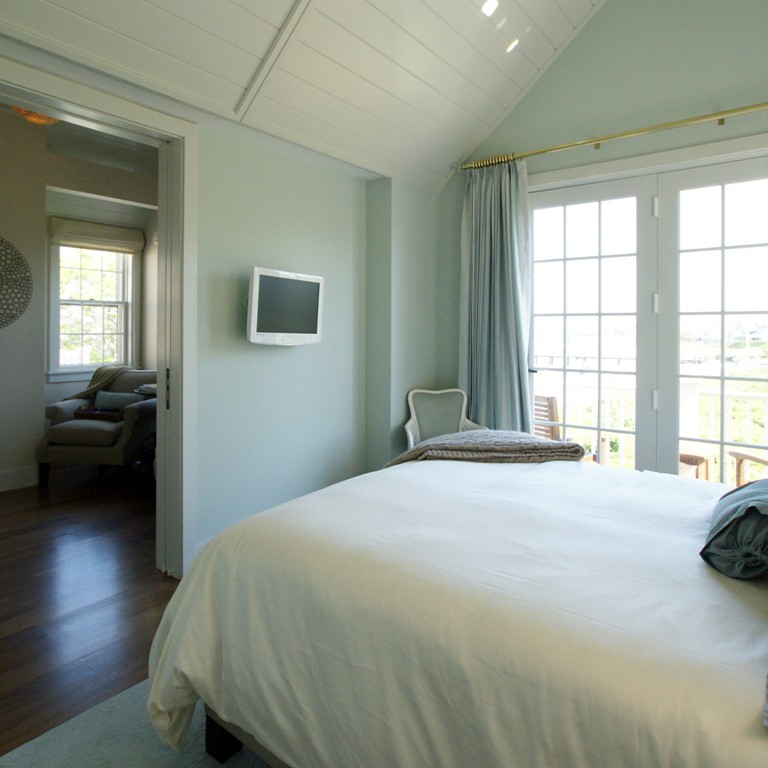 Bedroom interior design with green walls in a Nantucket home by Darci Hether New York