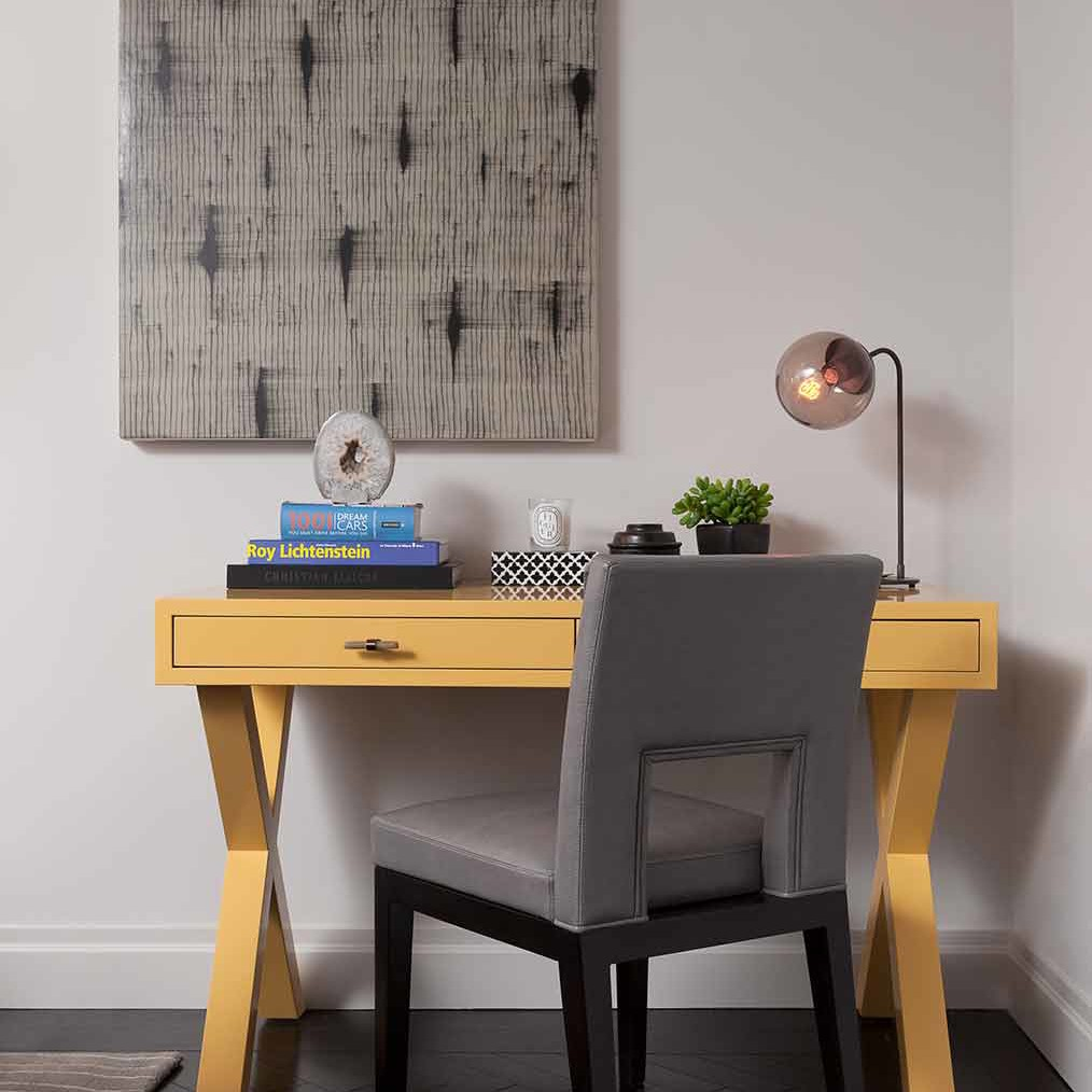 X Base desk and a wall art design in a NYC apartment designed by Darci Hether New York
