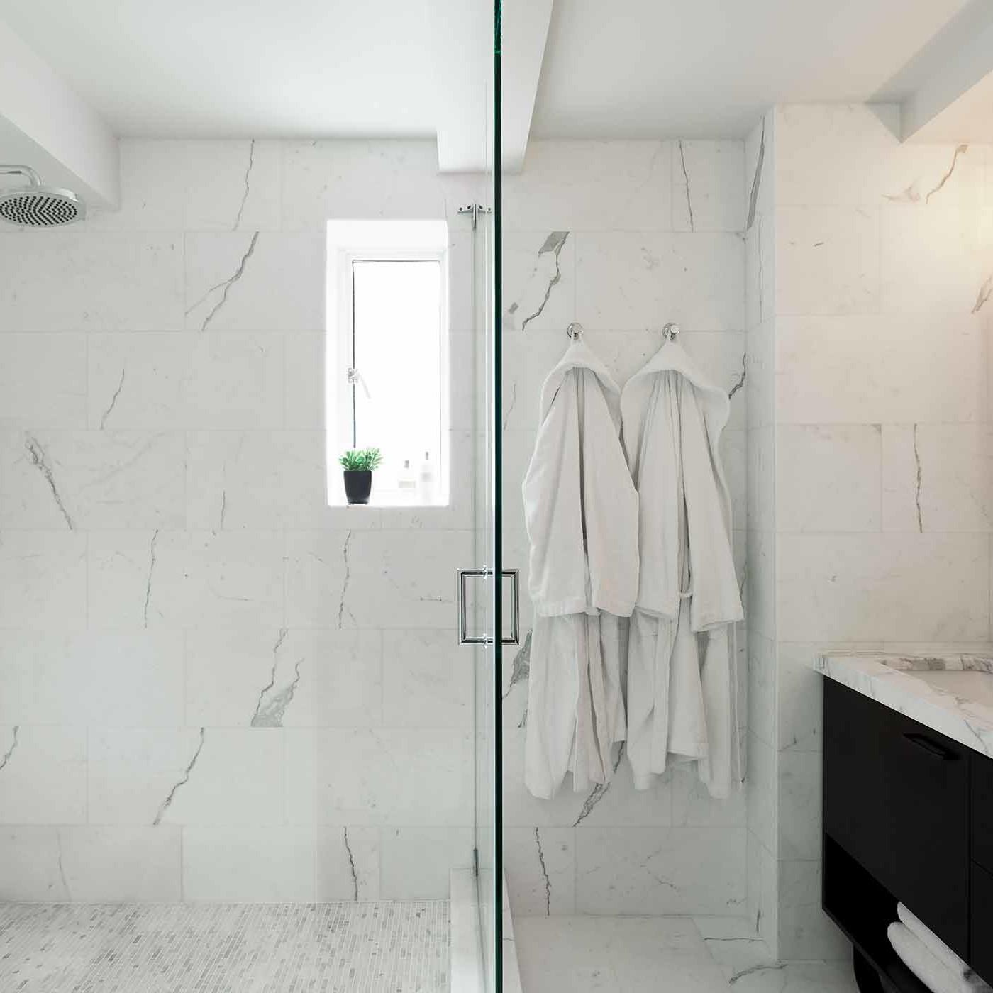 White marble master bathroom interior design by Darci Hether New York