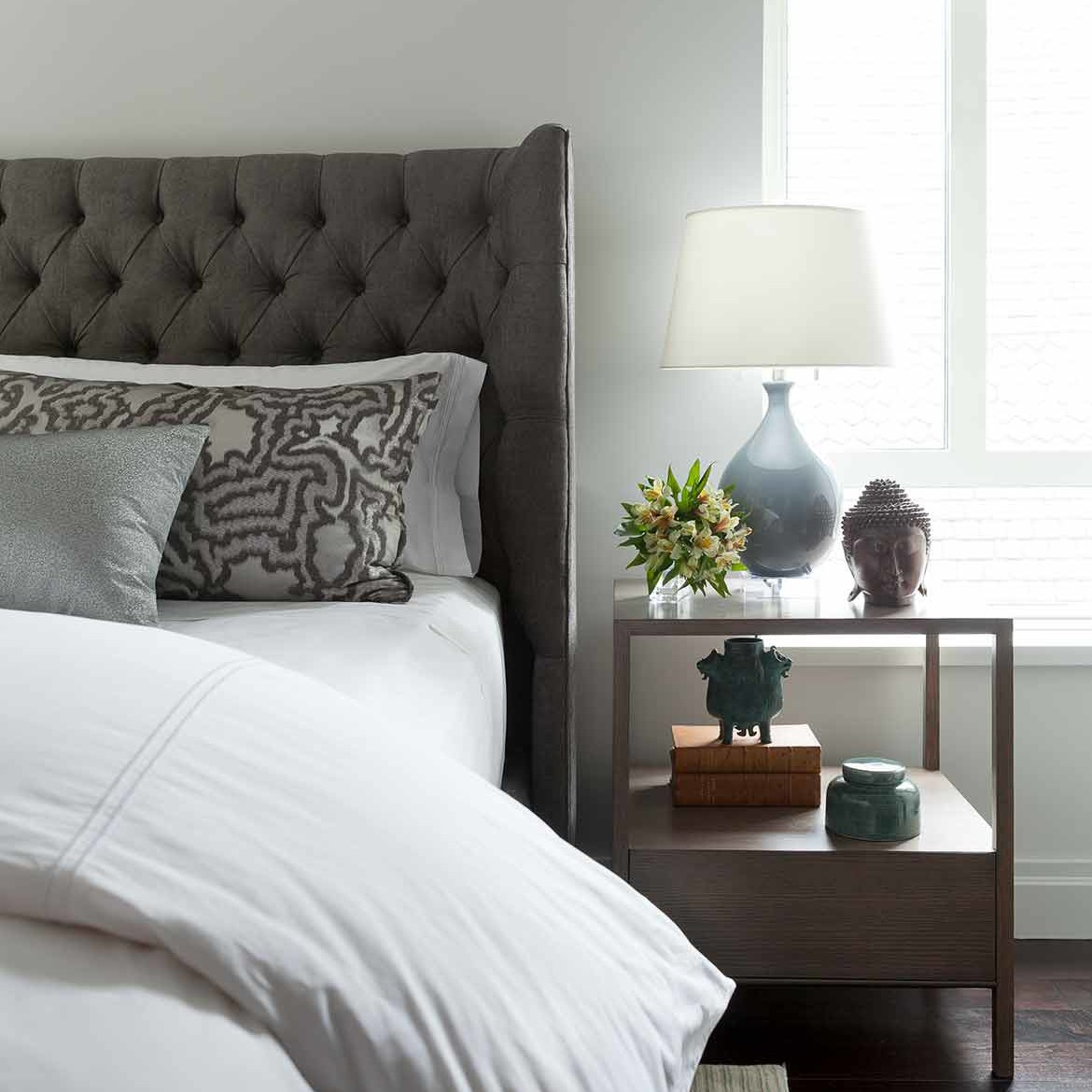 Guest room interior design with chic furnishings and hotel sheeting in a NYC apartment
