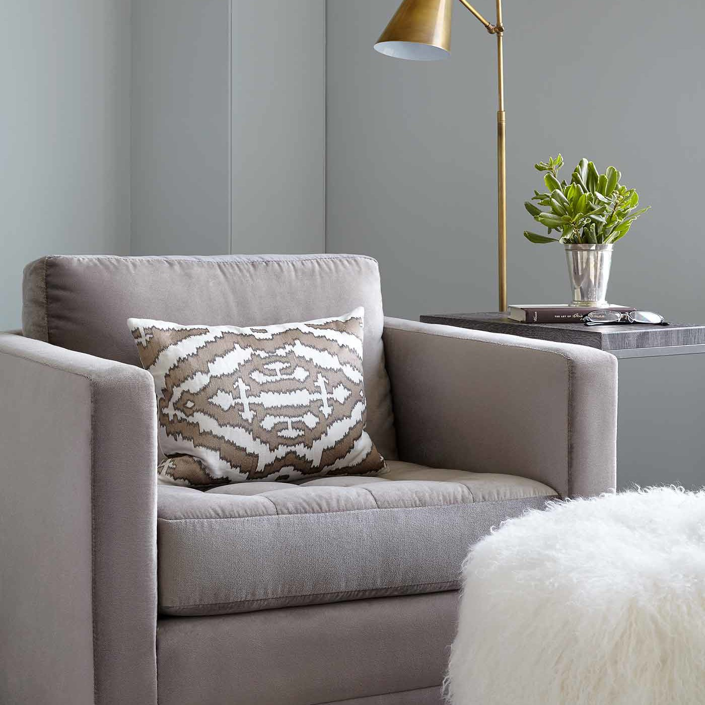 Arm chair in a NYC apartment interior design project by Darci Hether New York
