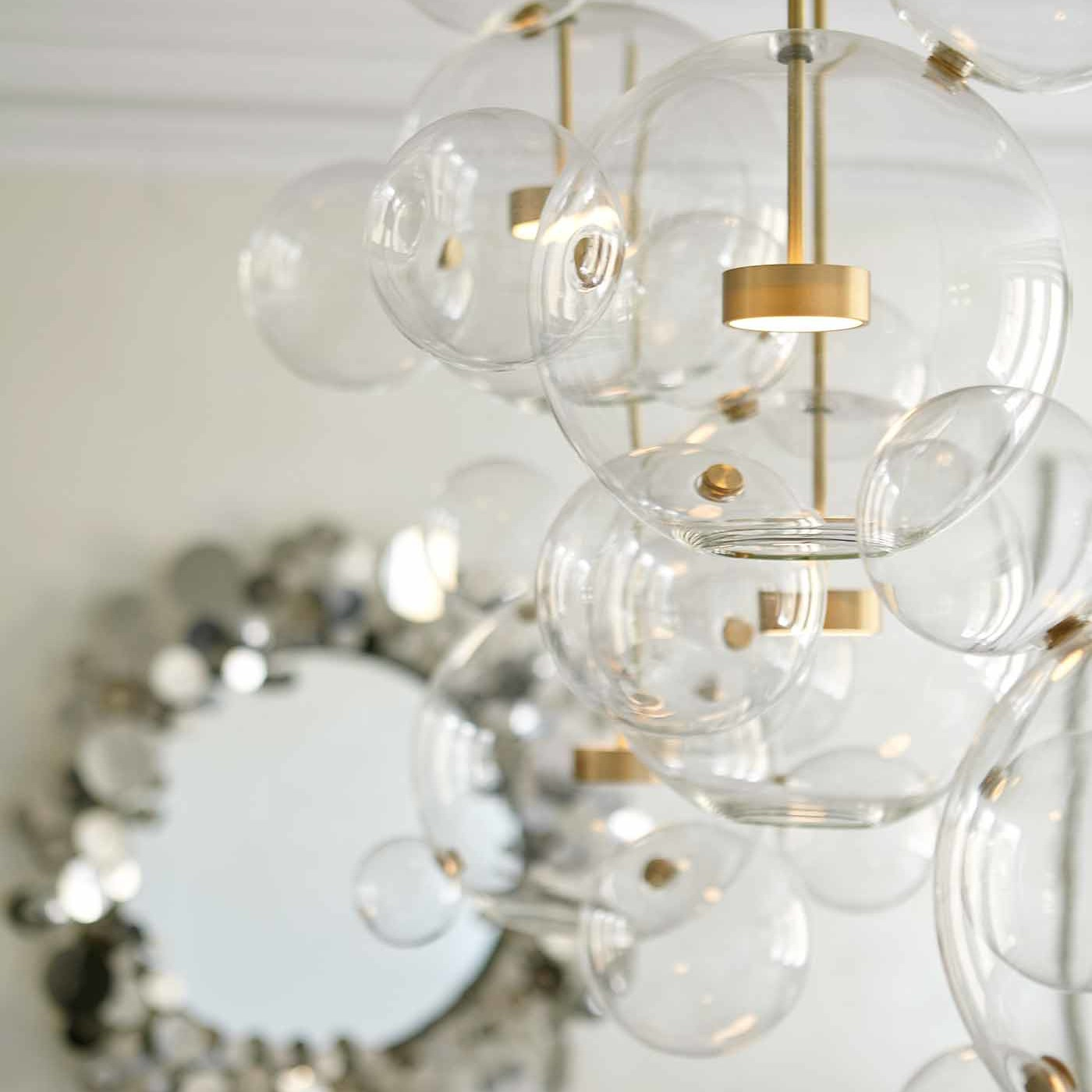 Custom made multi-bubble chandelier in a chic NYC dining room designed by Darci Hether New York