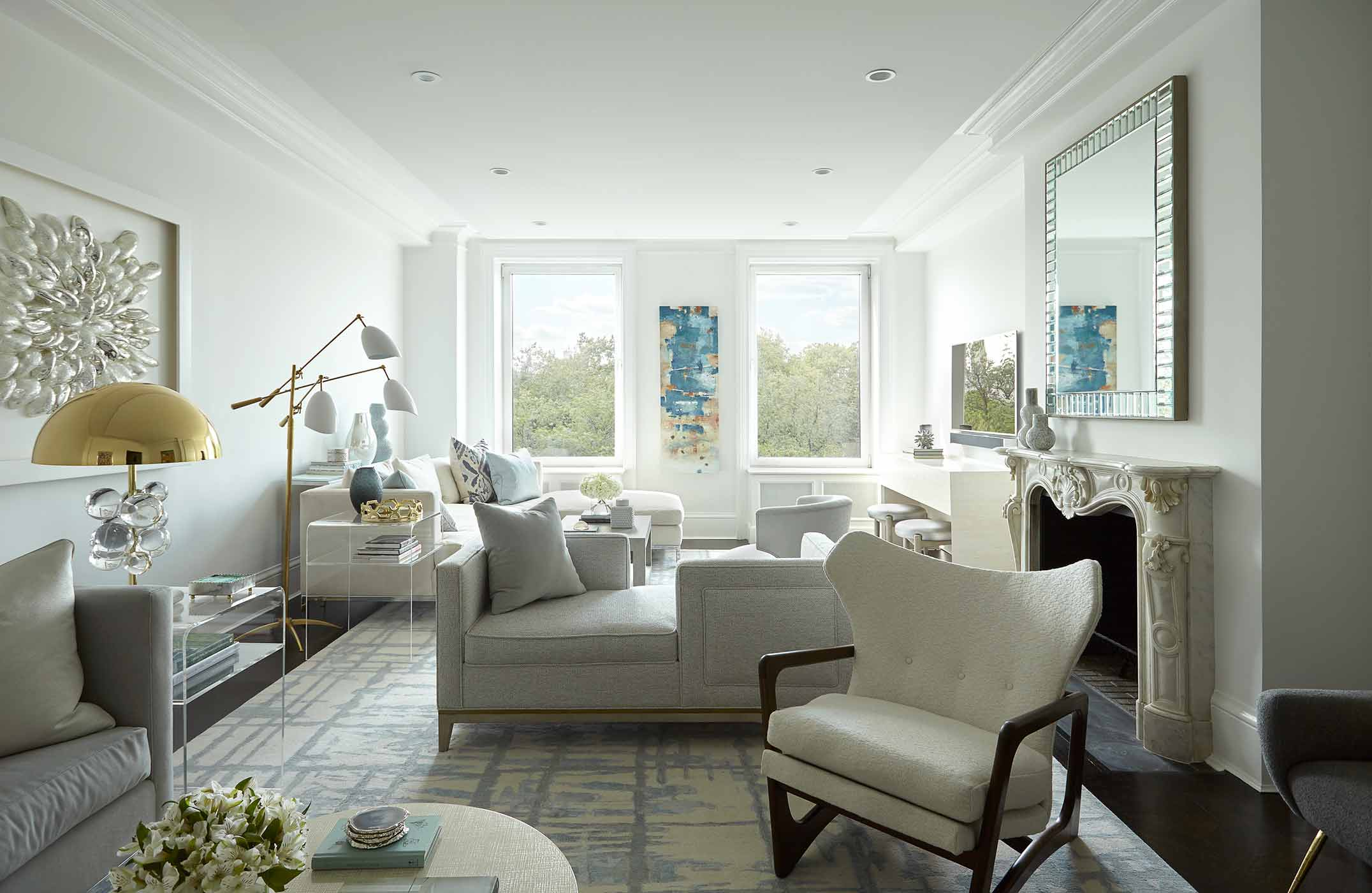 fifth avenue chic living room with mixed metals and abstract artwork and ornate marble fireplace - silver gold white grey - darci hether new york
