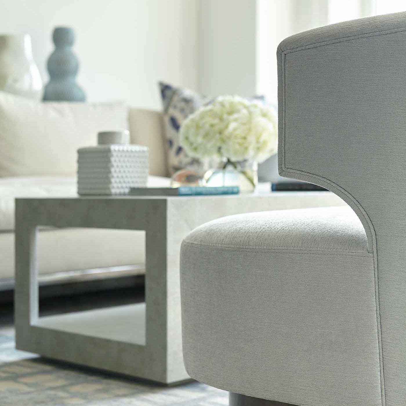 Creamy, linen-blend sofa in a NYC apartment living room designed by Darci Hether New York
