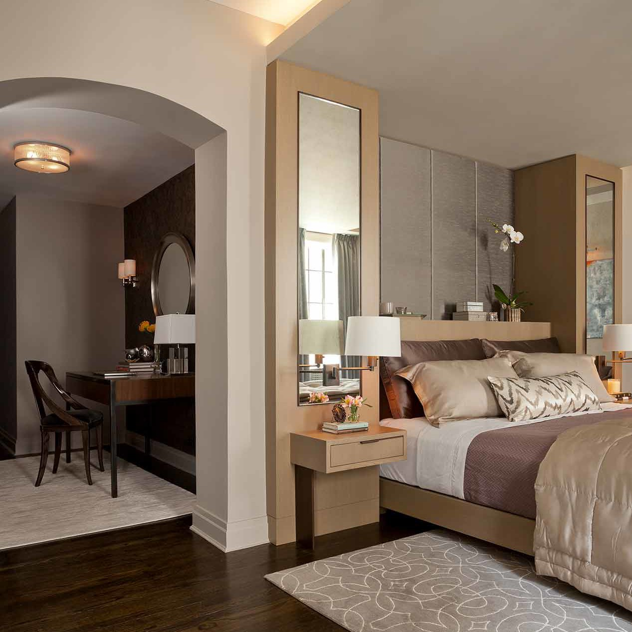 Contemporary pied-à-terre bedroom featuring gray walls complemented with a single-wall dark wood floor in NYC