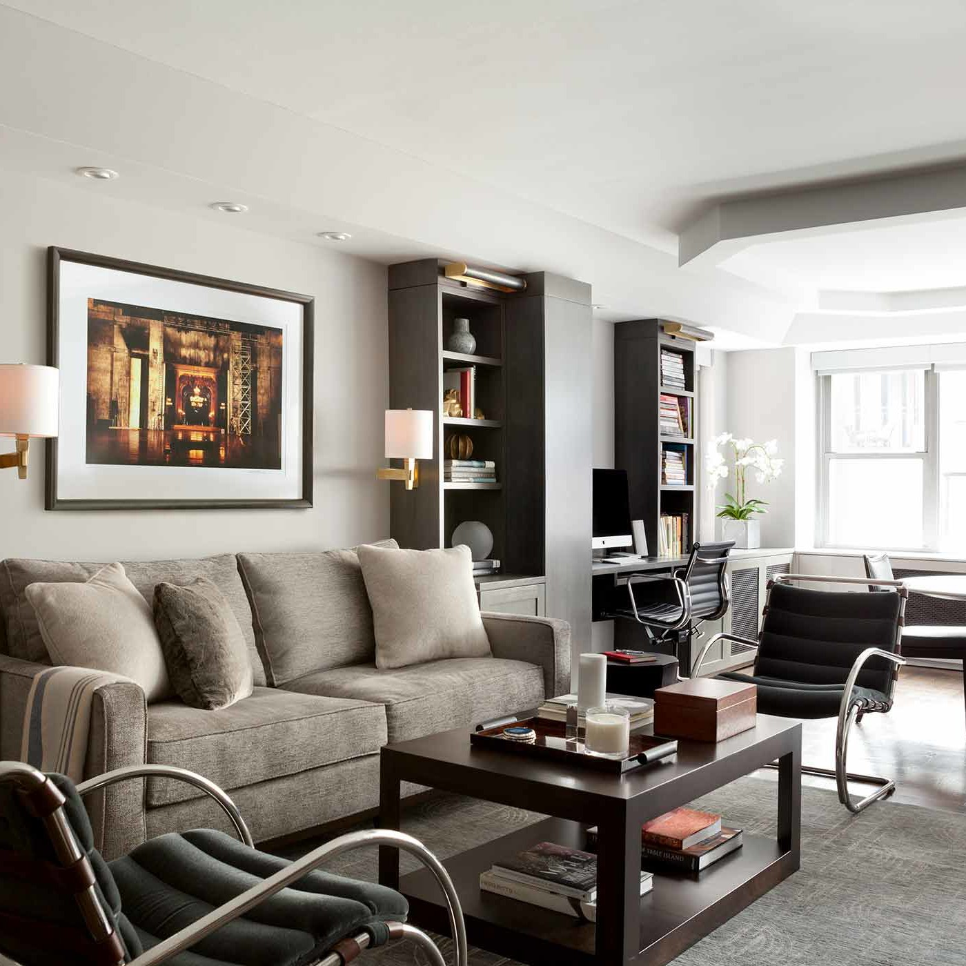 Open concept living room with adjacent office space in NYC designed by Darci Hether New York