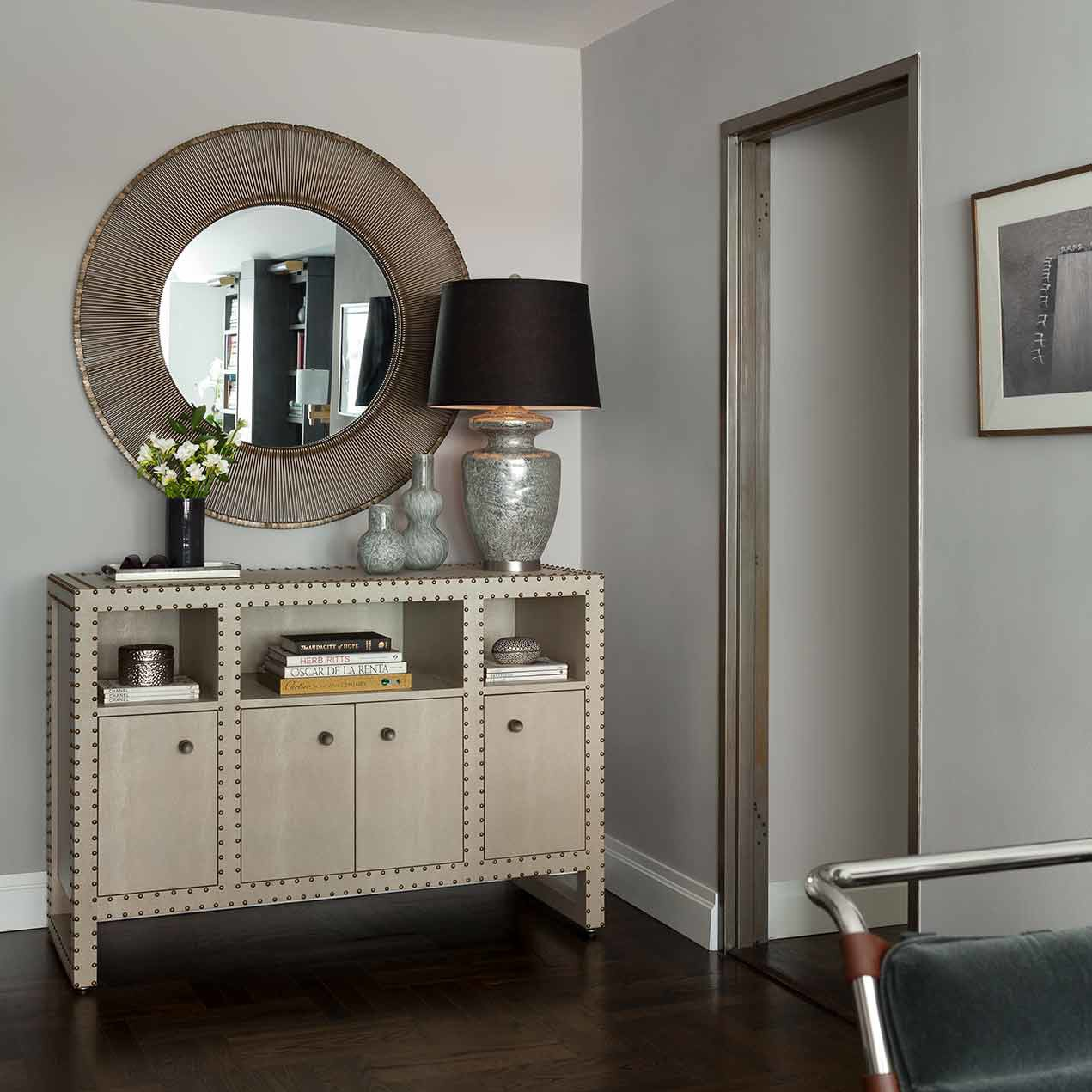 Custom made entry console in a one bedroom apartment renovation project by Darci hether New York