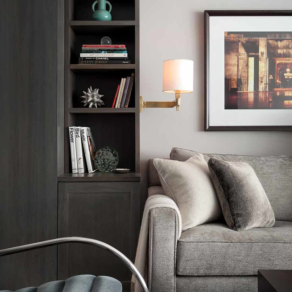 Detailed shot of custom built-ins, sconce lighting and furniture textures in a NYC apartment interior design project