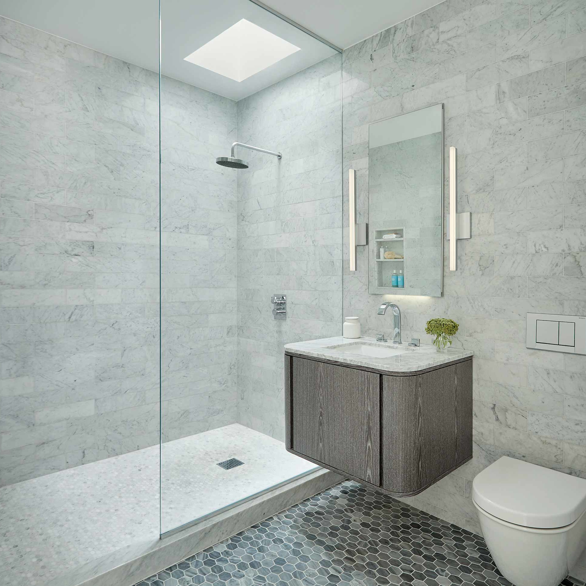 Bathroom with marble tiles, medium tone wood cabinets and a wall-mount toilet