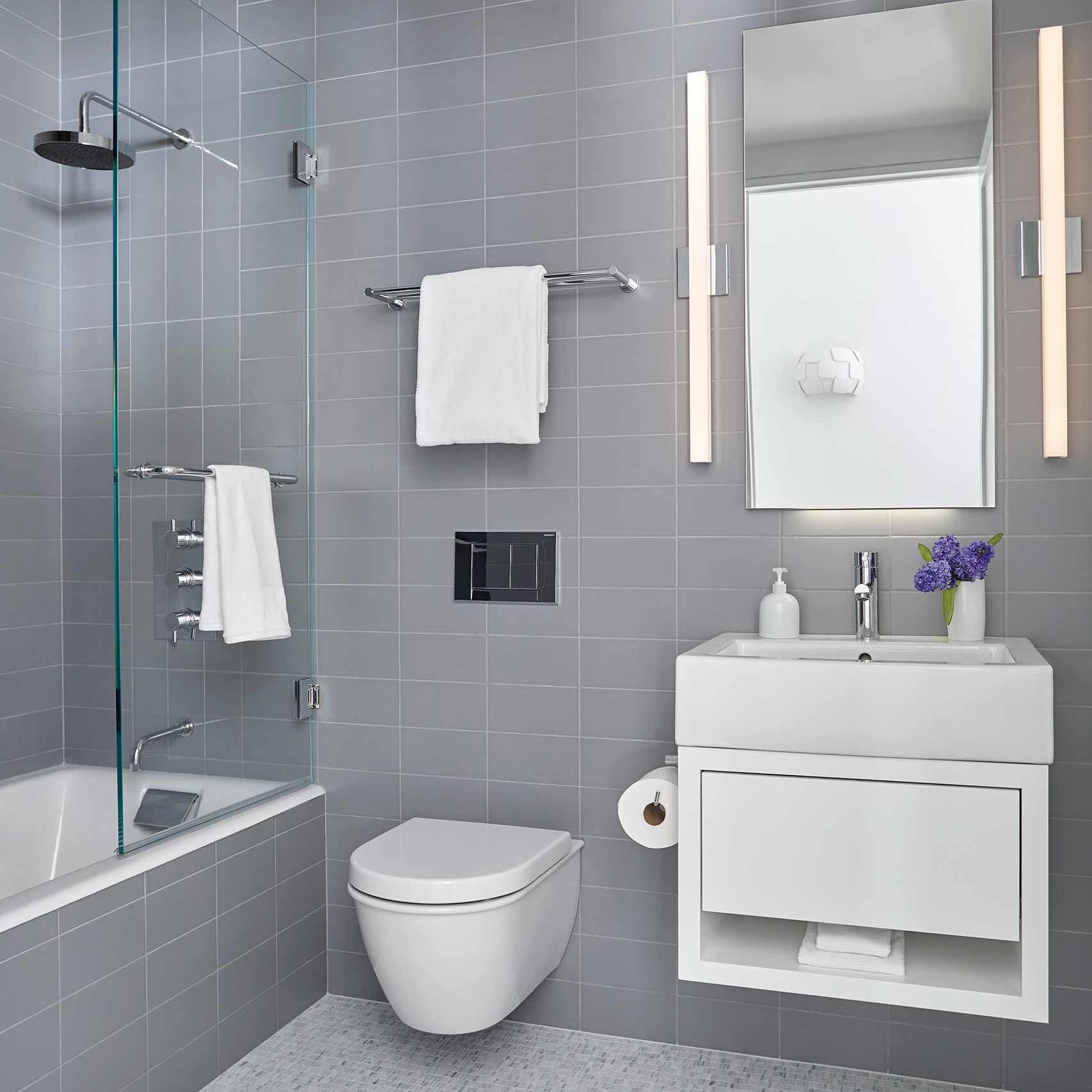 Bathroom with bathtub, walk-in shower, floating toilet and vanity