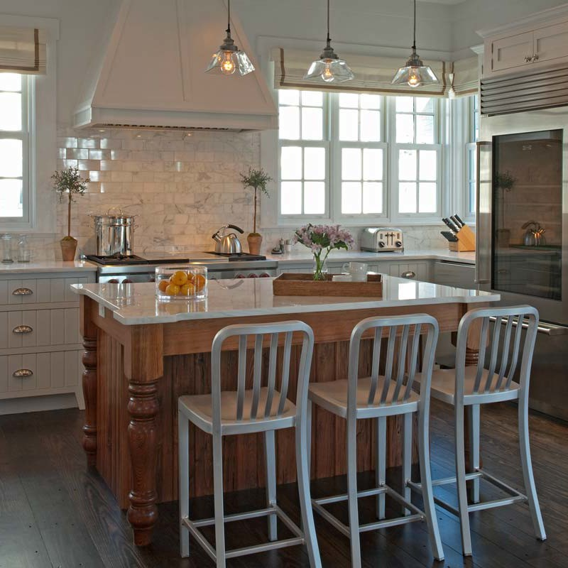 Eat-in kitchen remodel in Watersound beach with a farmhouse sink, white louvered cabinets and an island