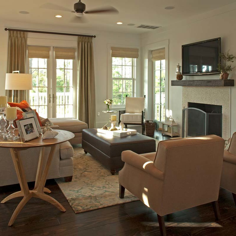 Watersound beach living room interior design with dark wood floors, white walls and comfortable furniture