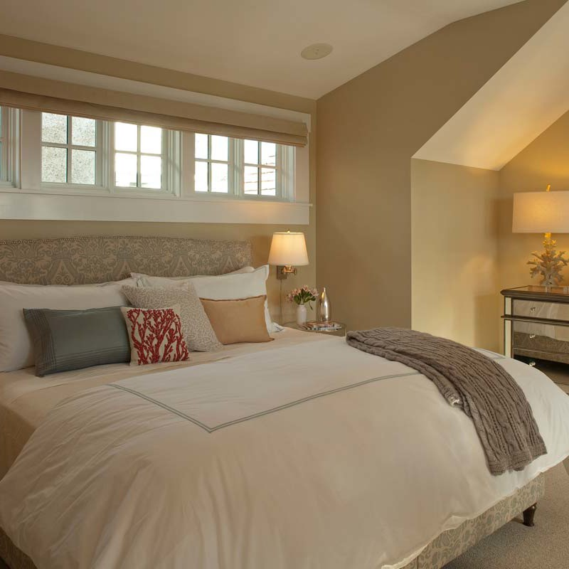Master bedroom showcasing a yellow palette with luxe linen and furnishing