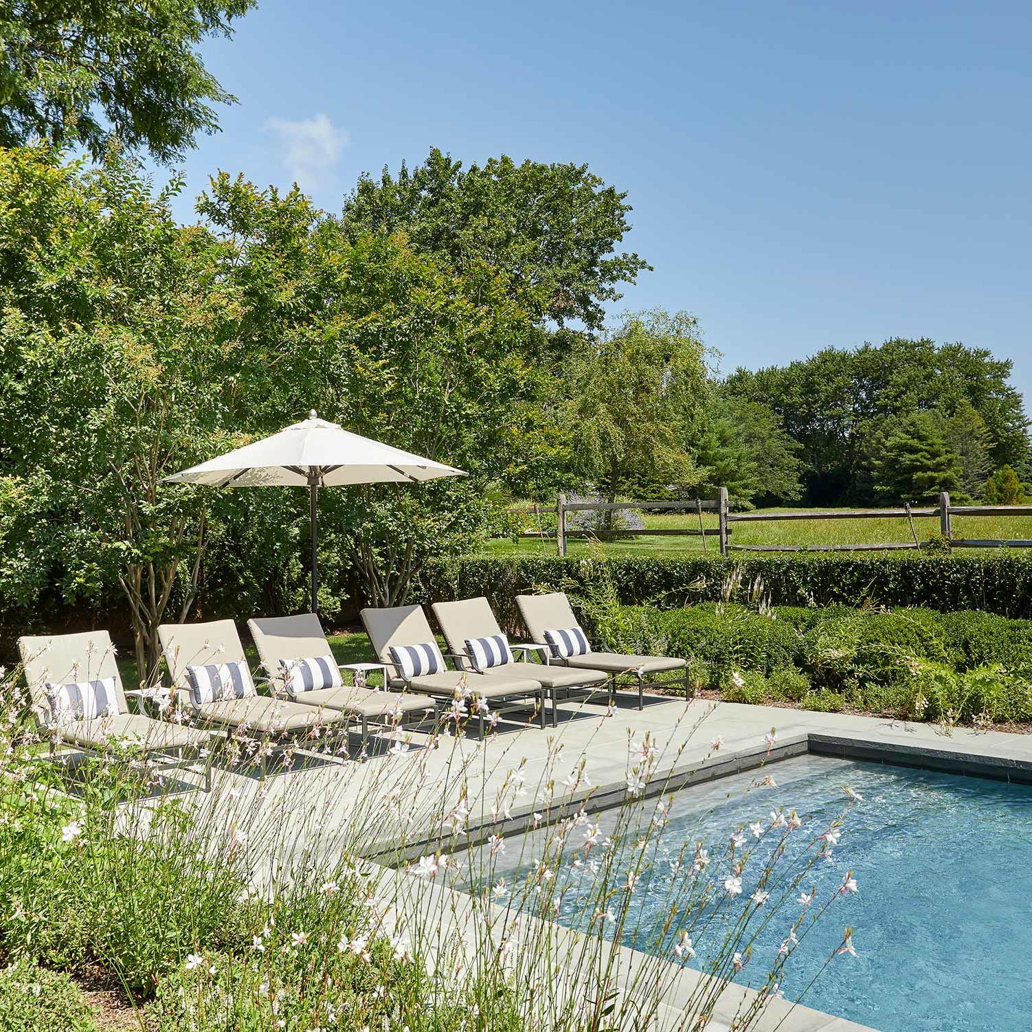 Backyard pool in a Bridgehampton family beach house designed by Darci Hether New York