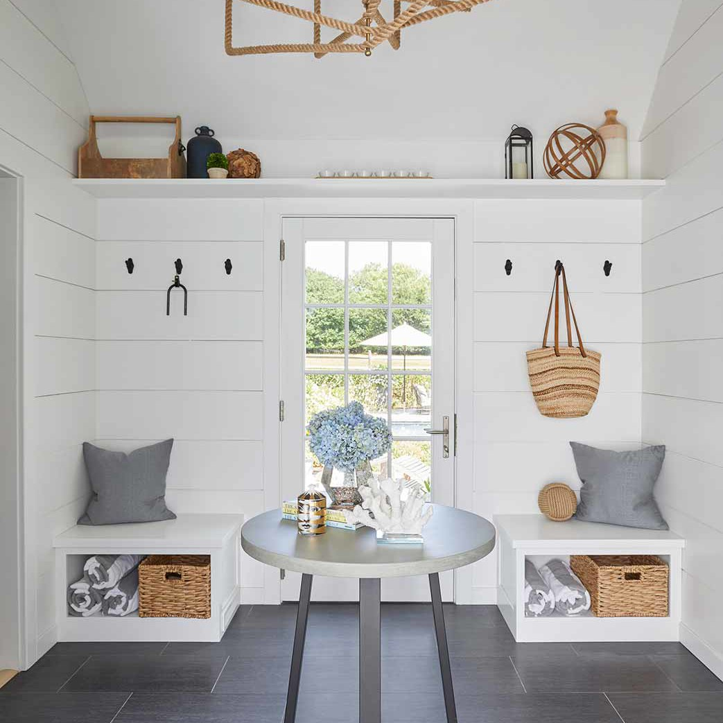 Beach style entryway in a Bridgehampton family home designed by Darci Hether New York