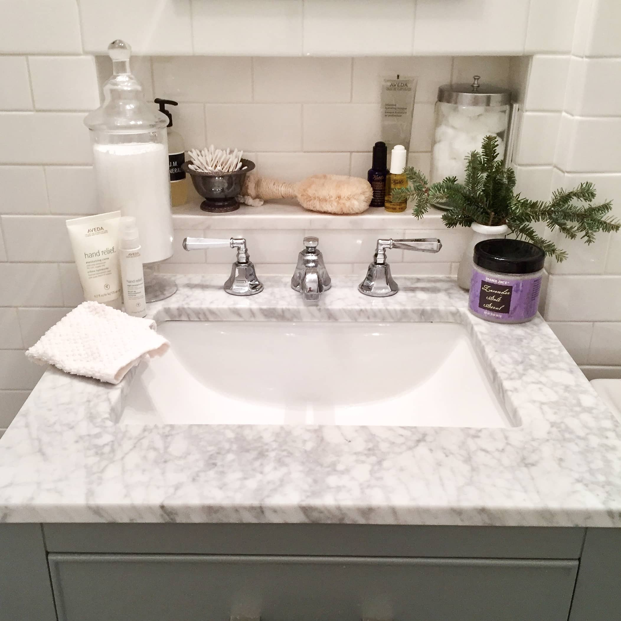 winter skincare products white subway tile bathroom