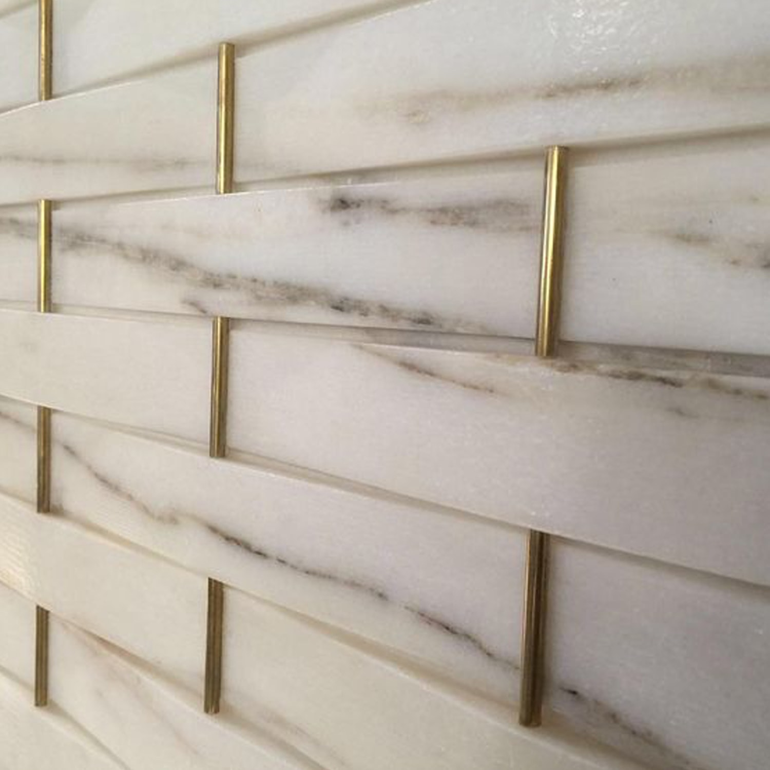 marble and brass tile backsplash
