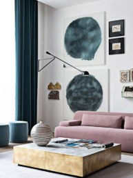 contemporary living room with a blush pink couch and navy accents