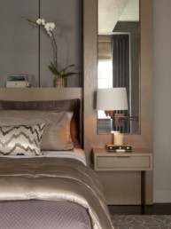 muted palette restful bedroom with built-ins and orchid
