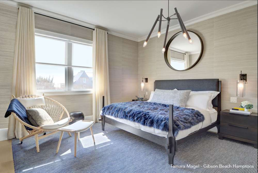 bedroom with blue throws and accents
