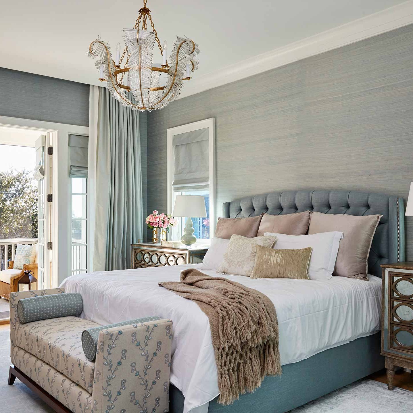 Bedroom with rich materials like silk grass cloth wallcovering and raw silk drapery in watery shades of green and blue
