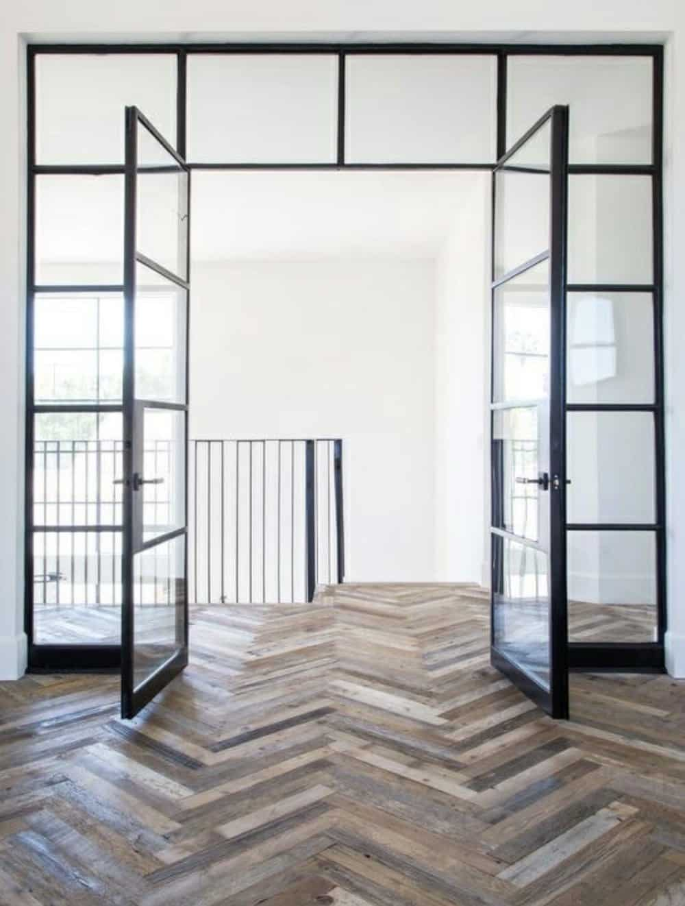 steel and glass french doors with herringbone wood flooring