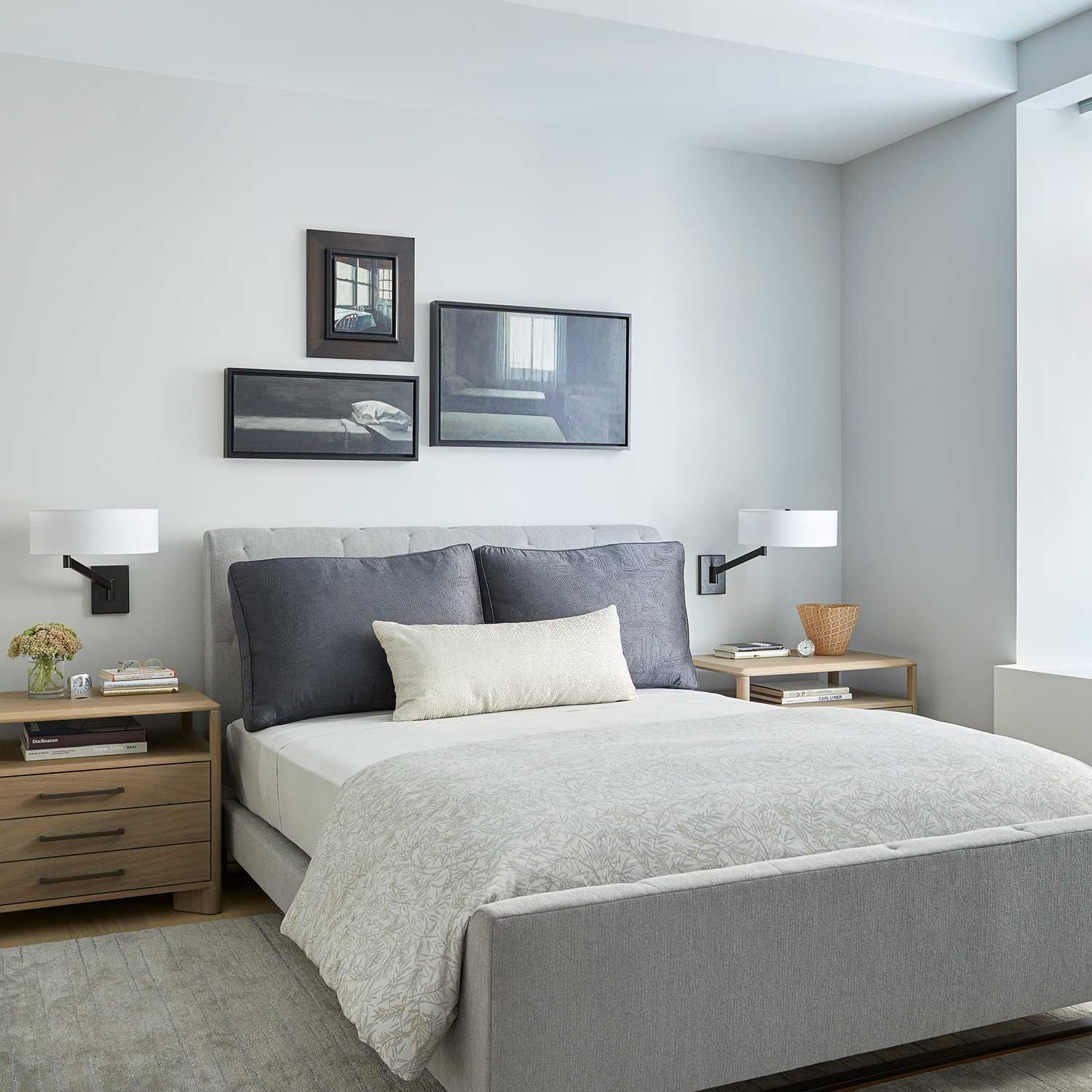 sleek gray colored master bedroom featuring a contemporary upholstered bed