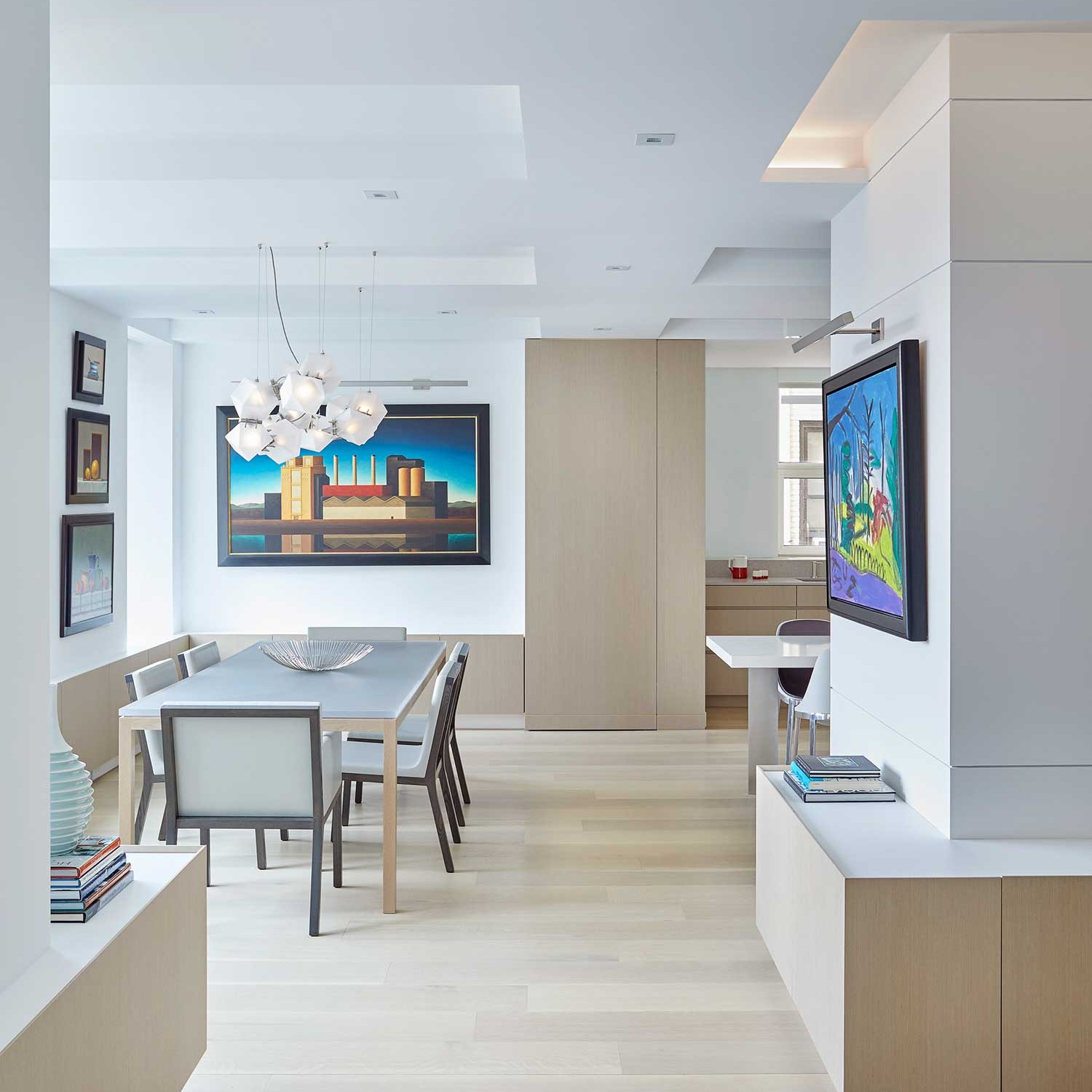 Custom built-ins for maximum storage in bleached oak wood in a NYC apartment