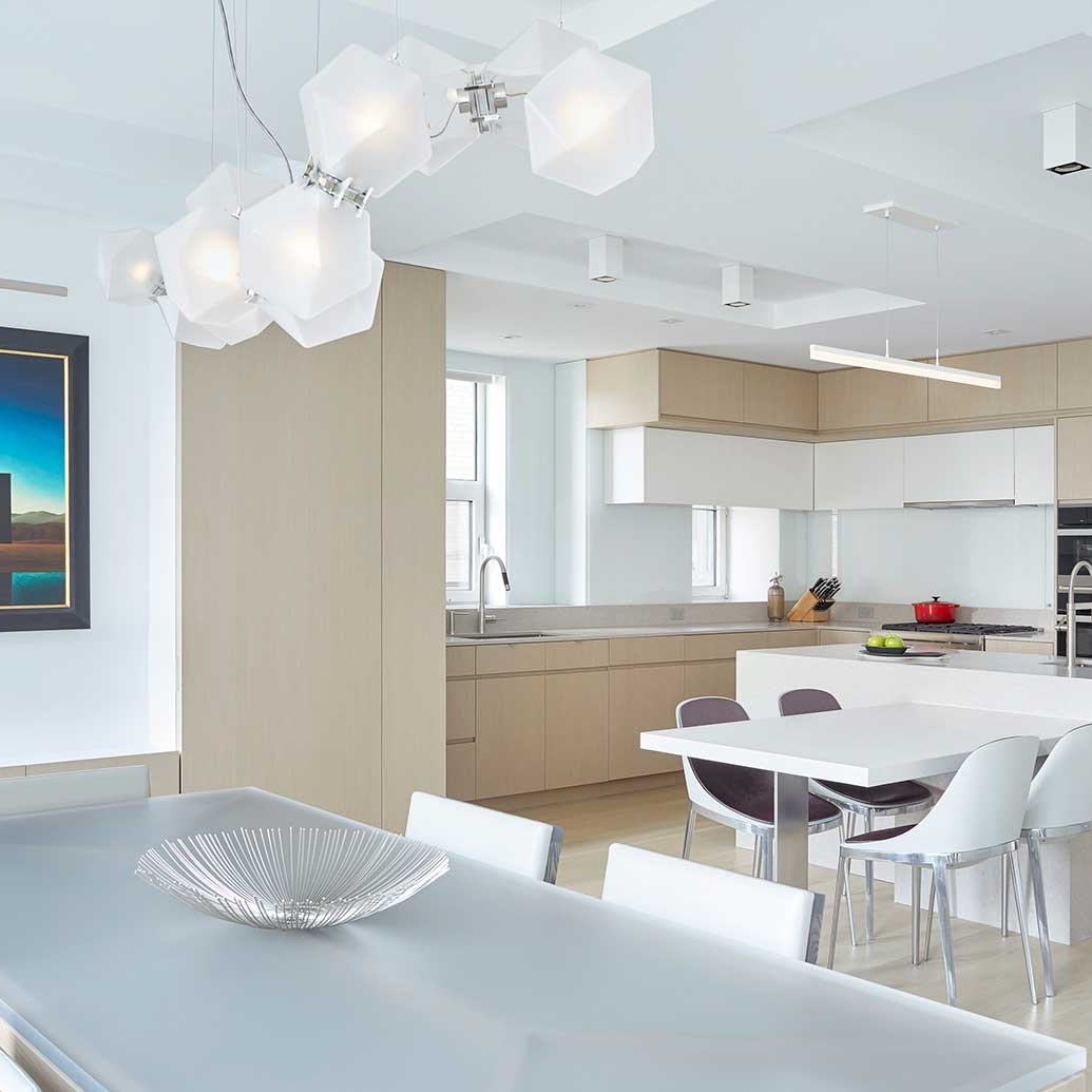Kitchen interior with bleached oak and high gloss white cabinetry designed by Darci Hether New York
