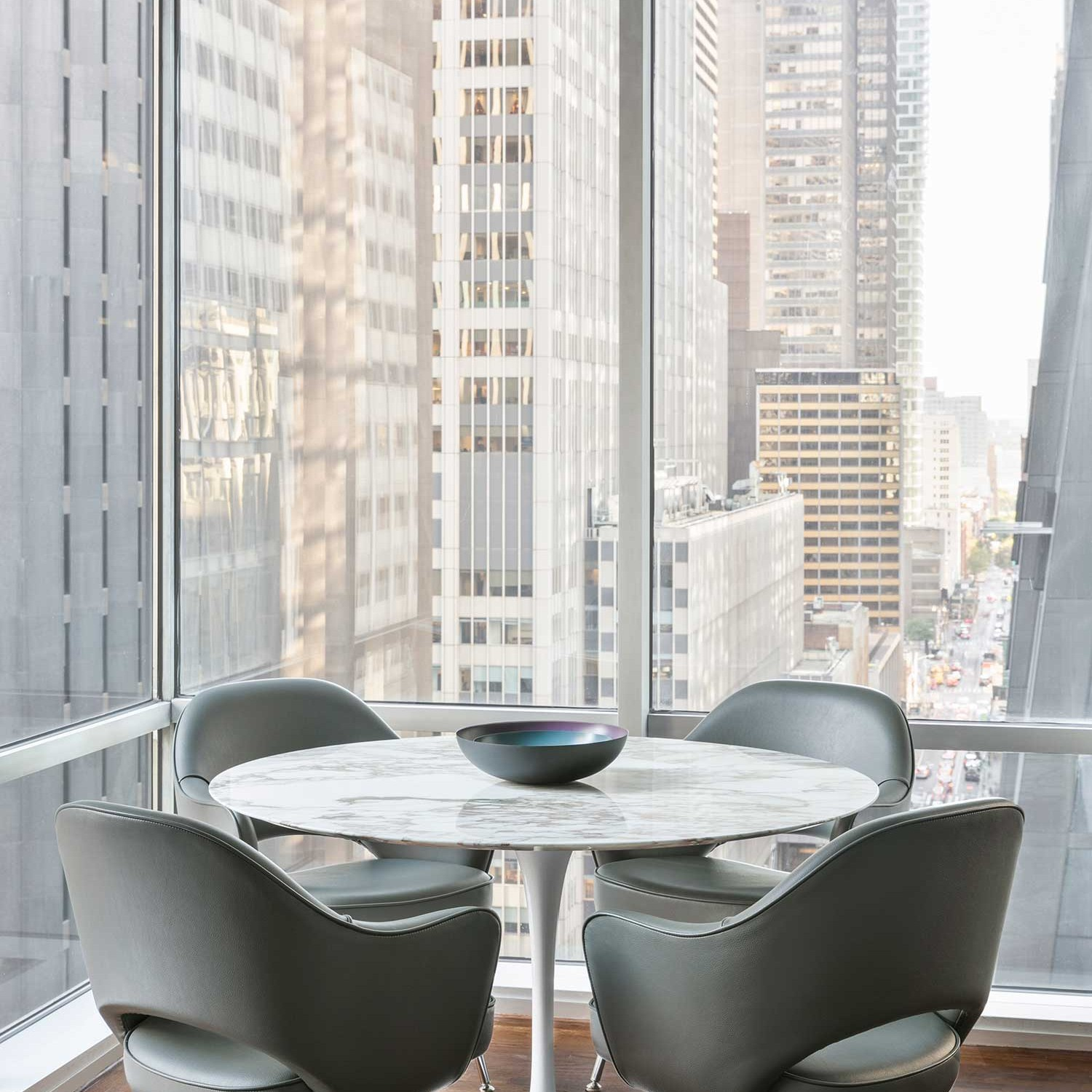 saarinen dining table and chairs add to this dining room with a view