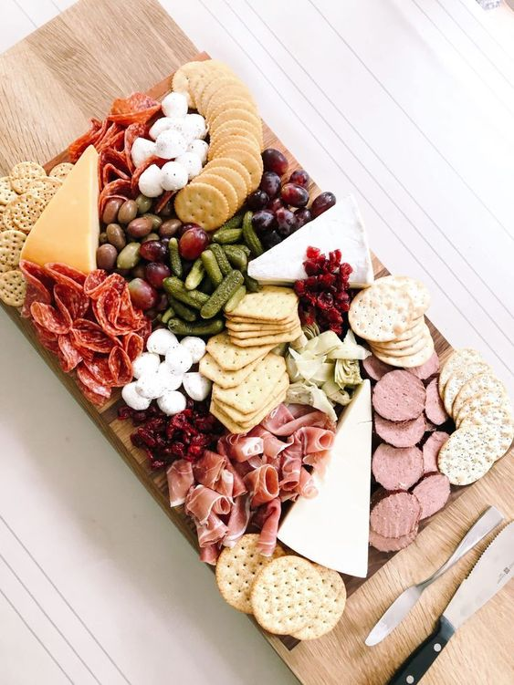 cheese board with various cheeses and meats