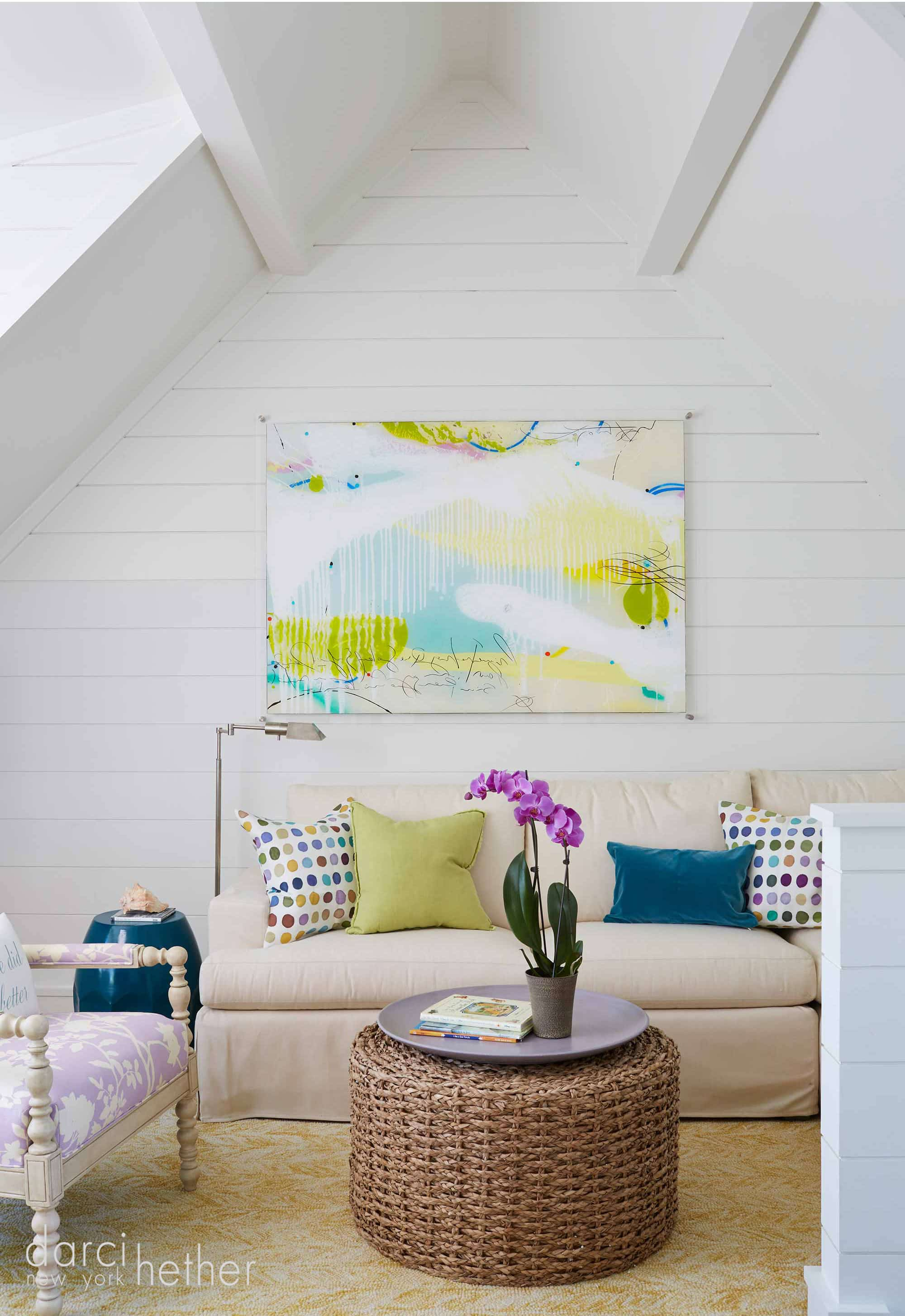 colorful beach house loft living room at 30A florida property designed by darci hether.