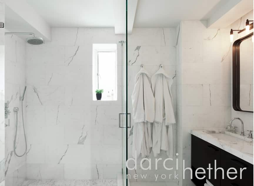 contemporary bachelor pad bathroom designed by darci hether new york located in upper east side. the bathroom has marble features.