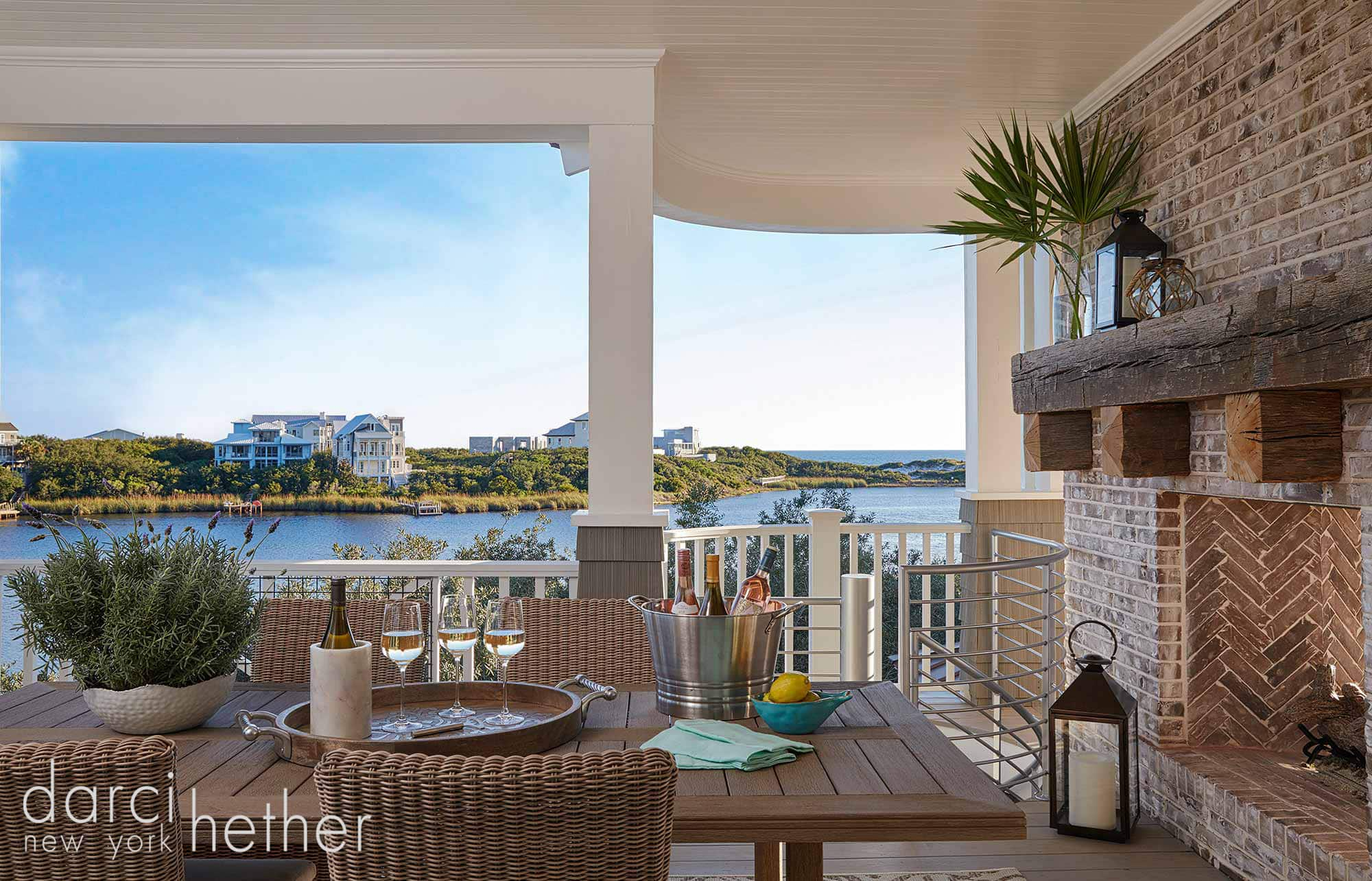 outdoor dining area with double sided fireplace of new beach house build at watersound florida 30A.