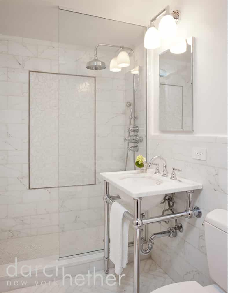 contemporary marble bathroom with pedestal sink designed by darci hether new york on the upper east side in new york city.