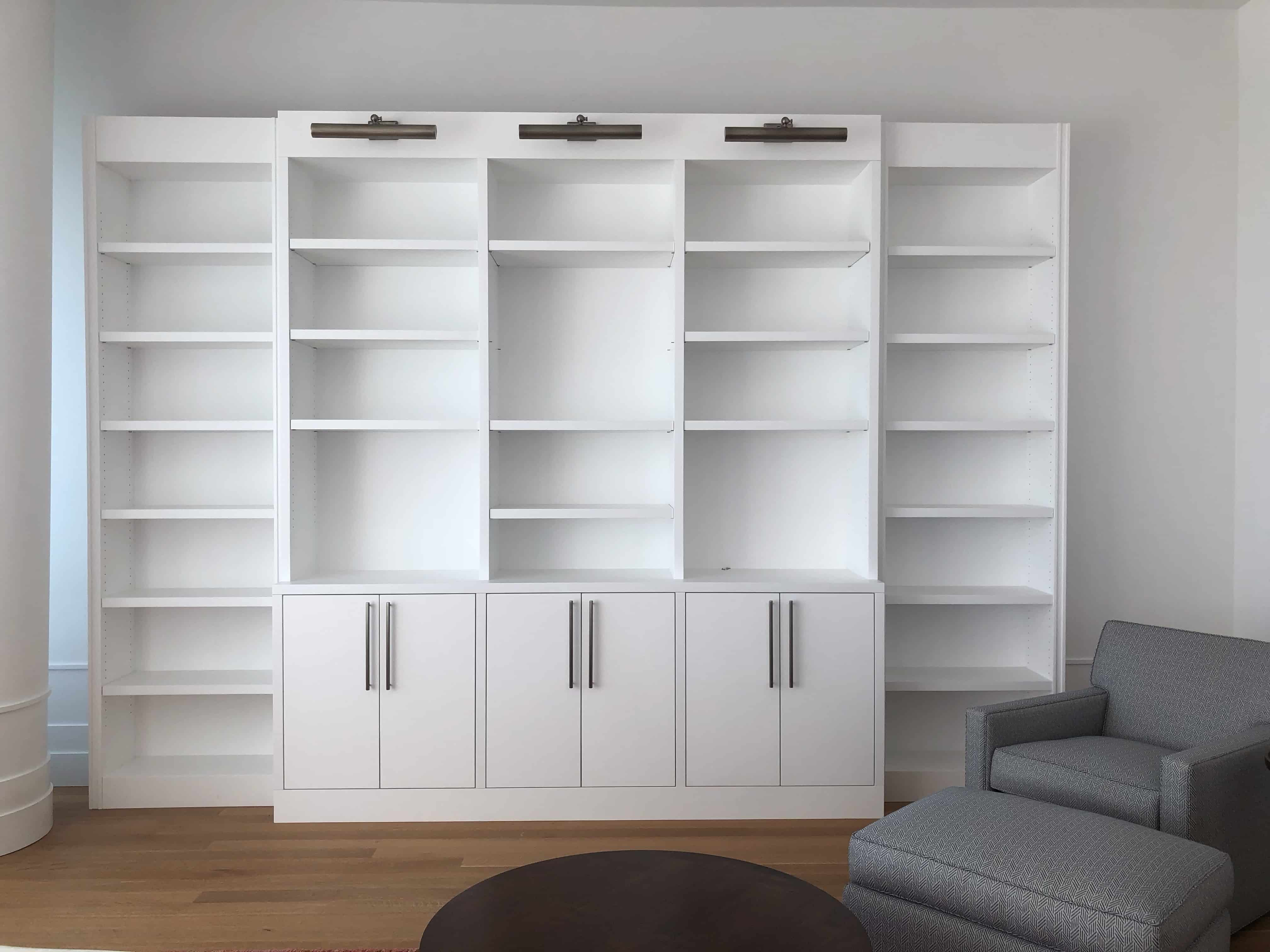 blank bookcase from bookcase styling tutorial by darci hether from a modern midtown apartment in new york city