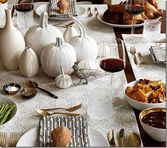 thanksgiving feast featuring simple white pumpkin centerpiece display