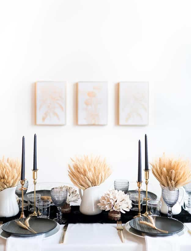 monochrome black and white thanksgiving decor table scape with chic wheat centerpieces