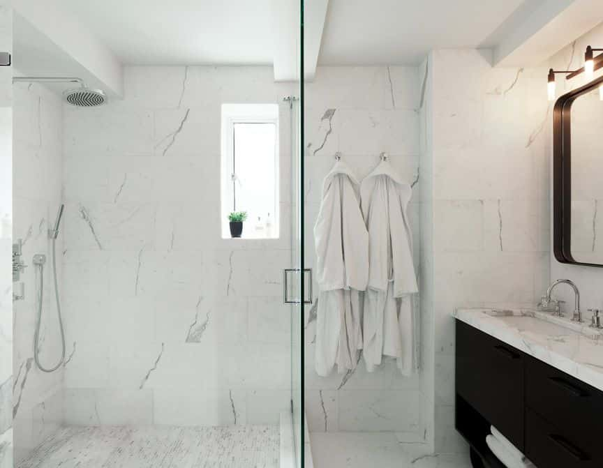 bachelor pad renovation park ave ny luxury interior design all marble shower spa white black vanity