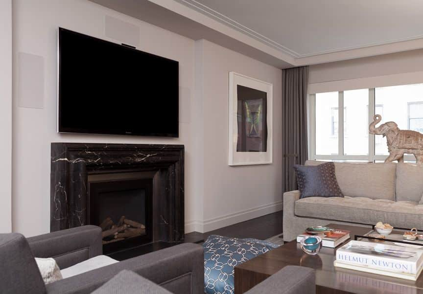 darci hether new york park ave living room renovation black stone fireplace art collection luxury