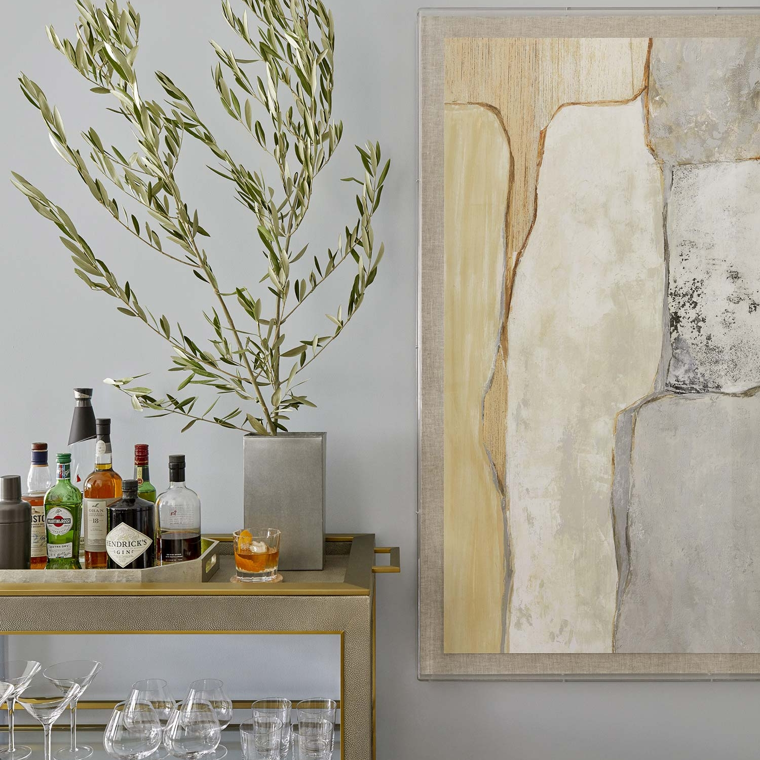 Classy bar cart and a large artwork in a NYC apartment design project by Darci Hether New York