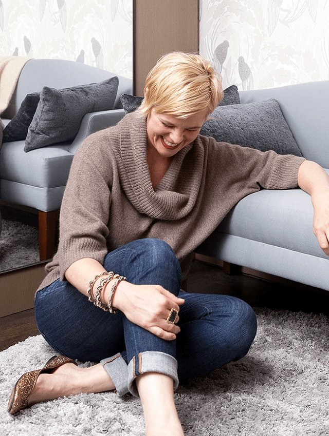 darci-hether-new-york_interior-designer_how-to-upscale-your-non-traditional-2020-thanksgiving_darci-launghing-while-leaning-on-couch