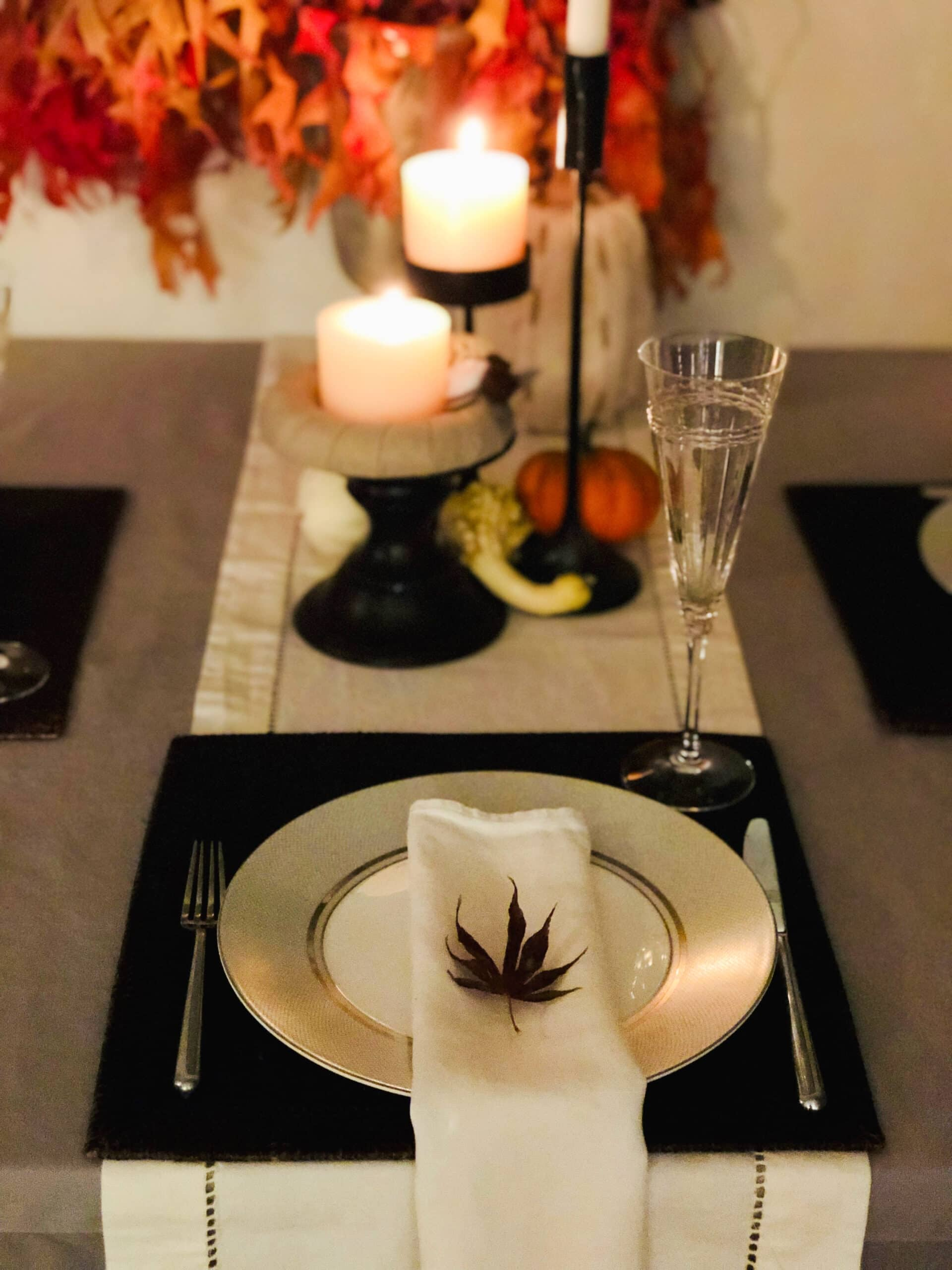 darci hether thanksgiving tablescape nyc tribeca candles champagne flute fall leaves
